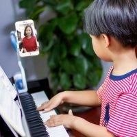柚子练琴助力音乐教育发展,让孩子不在畏惧